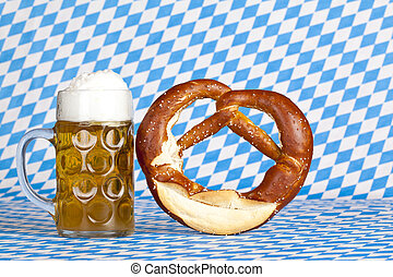 Oktoberfest beer stein with pretzel and Bavarian flag in...