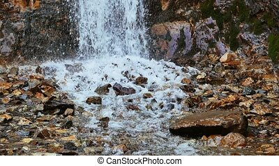 The water after the waterfall in the valley of the...