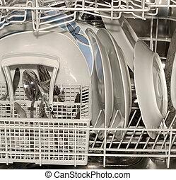 Dishwasher full of utensils, silverware