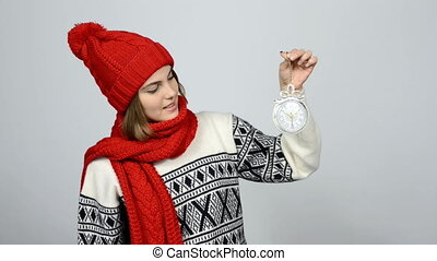 Countdown to holiday. Smiling girl in warm knitted hat and...