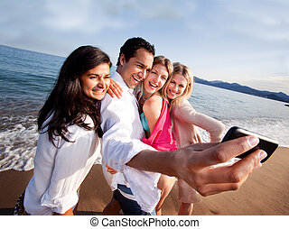 Holiday Self Portrait - A group of friends taking a self...