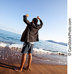Business Freedom - A business man with outstretched arms -...