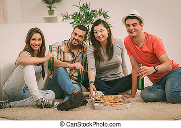 Hanging Out - Four cheerful friends hanging out in an...