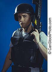airsoft sport player wearing protective helmet aiming pistol...