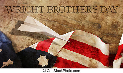 Happy Wright Brothers Day. America Flag and Wood. Paper...