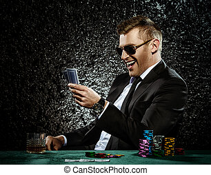 happy player - A wealthy mature man drinking brandy and...
