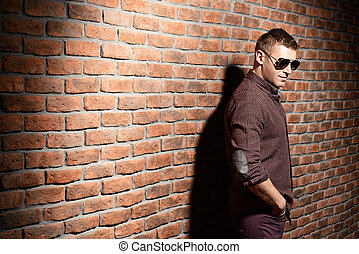 forceful man - Handsome mature man in sunglasses standing by...