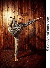 balance on one leg - Yoga. Yoga master practicing yoga....