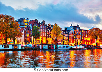 Amsterdam city view with Amstel river at sunset