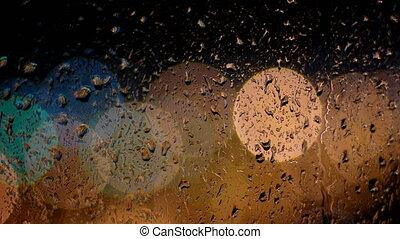 Raindrops running down the window glass