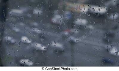 Day traffic Rain Bokeh over glass. Rainy day winter is...
