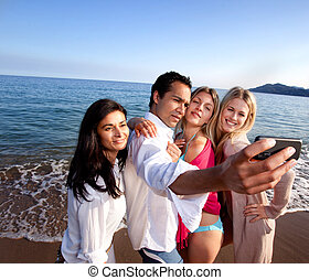 Cell Phone Portrait - A group of friends taking a self...