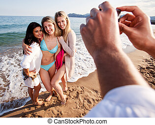 Camera Phone Beach Potrait - A group of women having their...