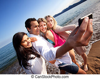 Self Portrait - A group of young adults taking a self...
