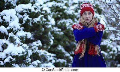Beautiful girl freezing in winter forest - Gorgeous woman in...