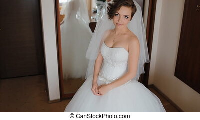 Portrait of beautiful young bride. Woman pose to...