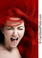 Rage - A furious young woman with her hair red like fire