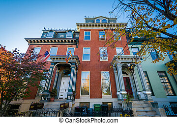 Rowhouses and autumn color near Franklin Square, in...