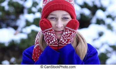 Attractive woman freezing outdoors in winter - Young pretty...