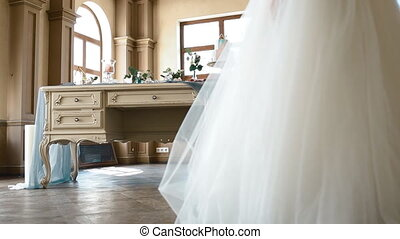 Beautiful bride posing near decorated table - Beautiful...