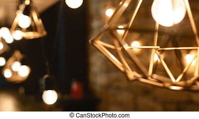 Decoration of the loft bar. Lamp with geometric form. Camera...