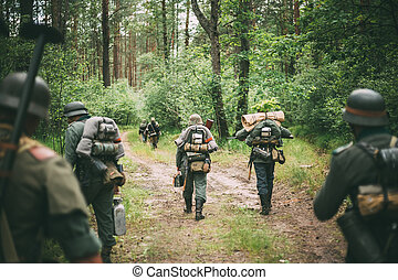 Unidentified Re-enactors Dressed As German Soldiers Marching...
