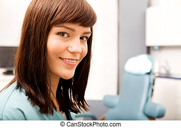 Dental Hygienist - A portrait of a dental hygienist in front...