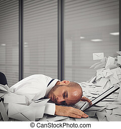 Buried by worksheets and spam - Businessman on laptop with a...