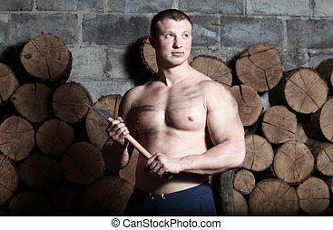 Man with hatchet - Young strong man with hatchet and a lot...