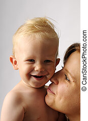Little boy with mother - The portrait of young happy mother...