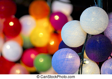 Multicoloured ball shaped Christmas lights - Close-up of...