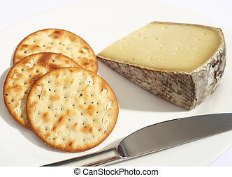 Tomme de Savoie cheese and biscuits - A wedge of Tomme de...