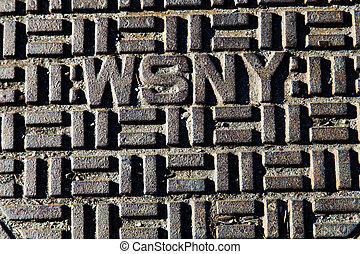 WSNY Manhole Cover Close Up - Detail of a manhole cover of...