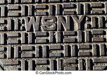 WSNY Manhole Cover Close Up - Detail of a manhole cover of...