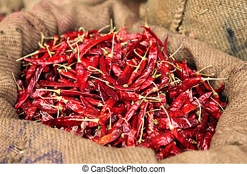 Dried chillies in a sack - A sack full of dried hot red...