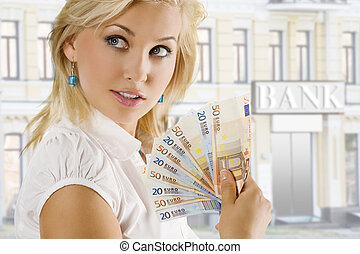euro woman - cheerful young blond lady holding euro cash and...