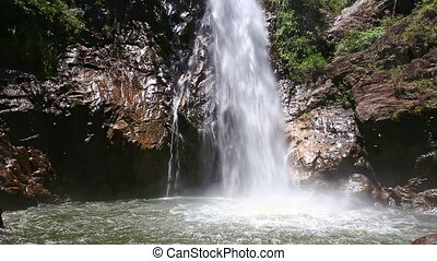 Closeup Mountain River Waterfall Falls into Lake among Rocks...