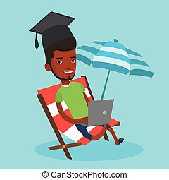 Graduate lying in chaise lounge with laptop. - An african...