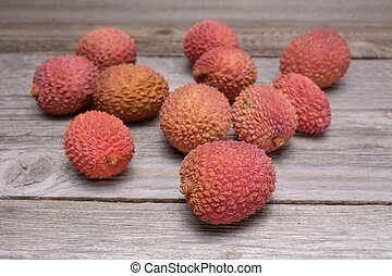 Lychee, Fresh lychee and peeled showing the red skin and...