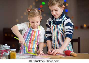 Happy  little children preparing Christmas cookies