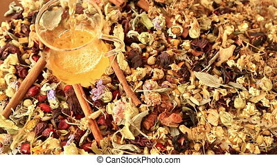 Cup of tea with different kind of healing herbs - Overhead...