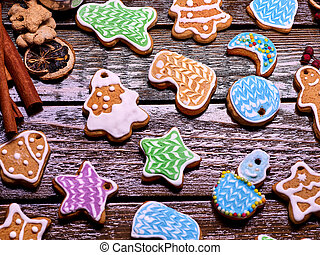 Glazed Christmas gingerbread on a wooden table. - Glazed...