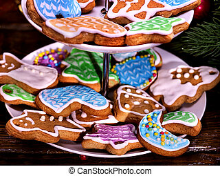 Christmas cookies covered with colored glaze on Tiered,...