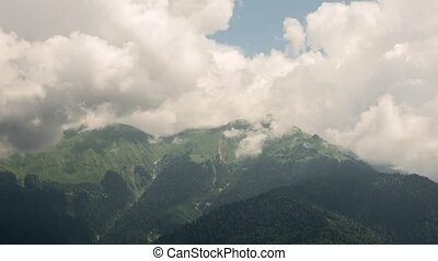 Clouds in the mountains. Zoom. Ridge Aibga, Rosa Khutor,...
