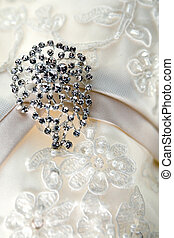 Diamond jewelry on vintage wedding dress - Silver brooch on...
