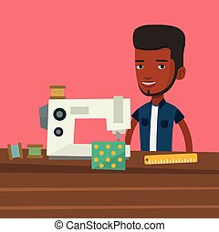 Seamstress using sewing machine at workshop. - African male...