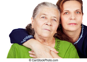 Family studio portrait - happy daughter and her old mother -...