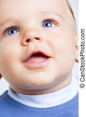 Happy cute baby boy with blue eyes - Portrait of happy cute...