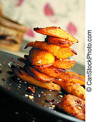 Stack of plantain chips on plate at - Beautifully presented...