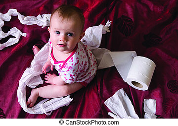 Baby tearing up paper - Down shot of naughty surprised baby...